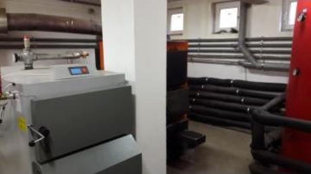 Montaj centrala termica pe combustibil solid de la Mocuta Instal Srl